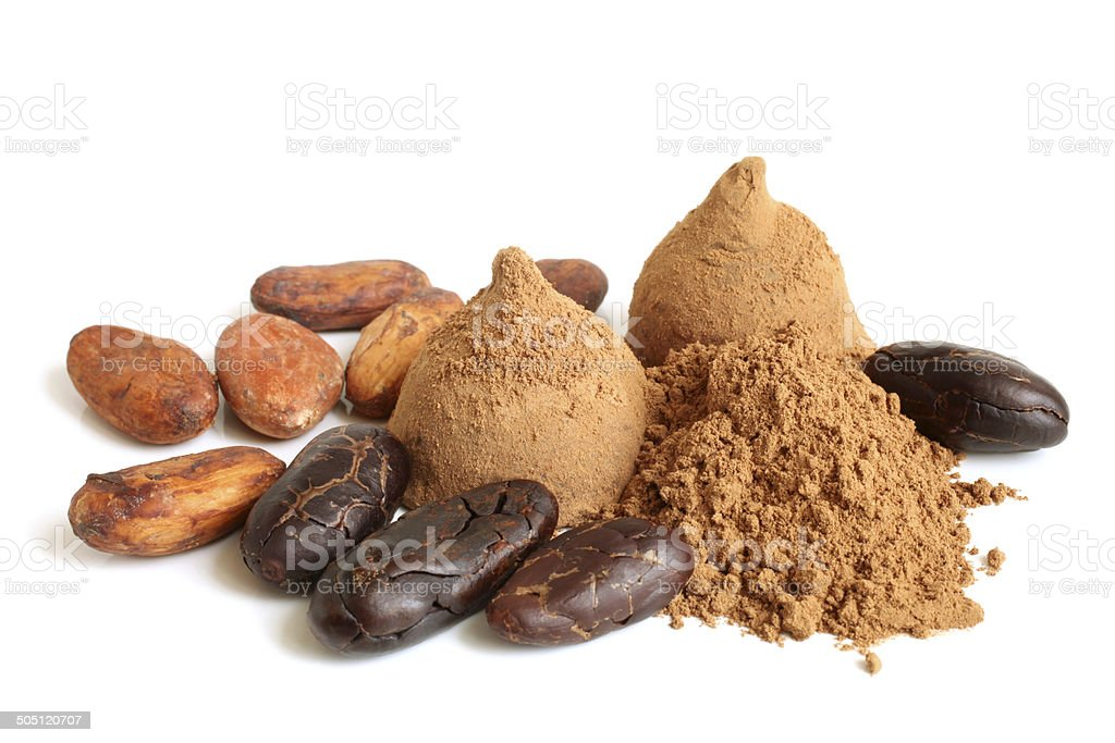 Cacao beans, cacao powder and chocolate sweets stock photo
