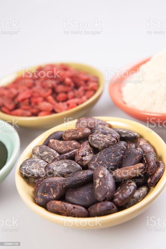 cacao beans, goji berries, spirulina, maca royalty-free stock photo
