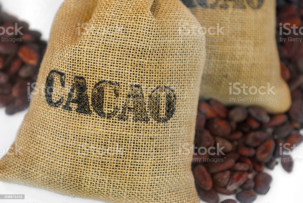 cacao beans in jut bag with inscription 'cacao' stock photo