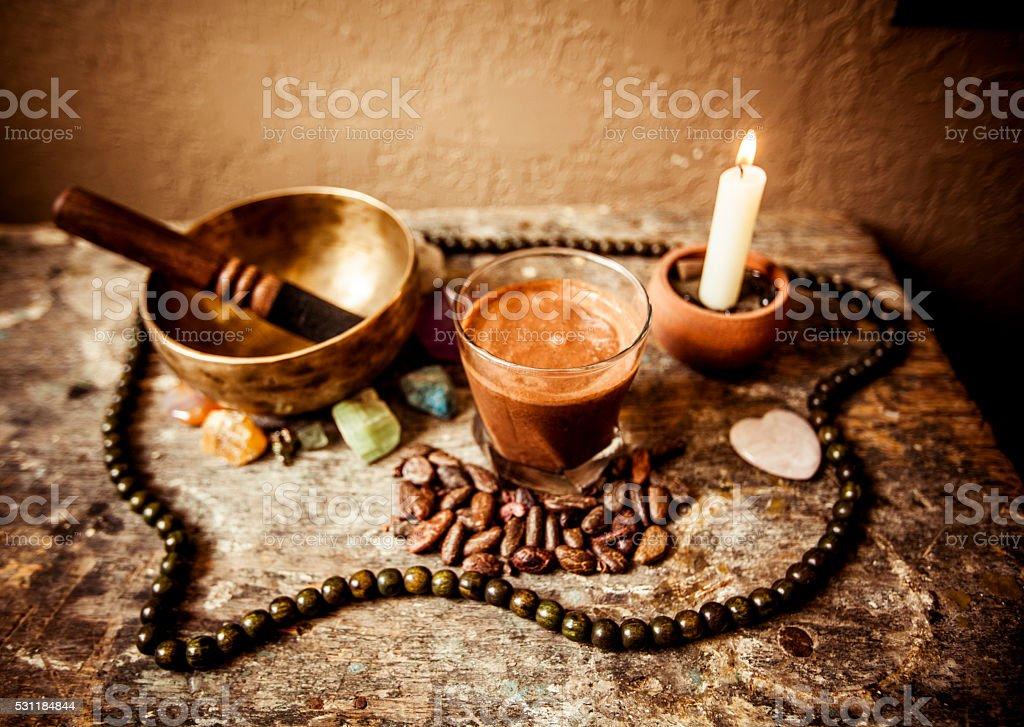 Cacao Beverage, Tibetan Singing Bowl and Gemstones stock photo