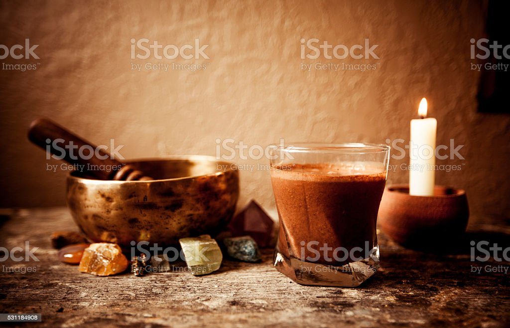 Cacao Beverage, Tibetan Singing Bowl and Gemstones stock photo