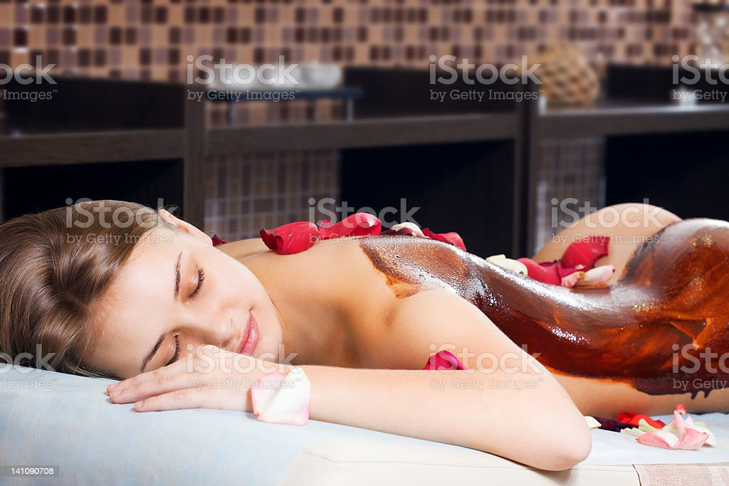cacao therapy applied to young woman in a spa stock photo
