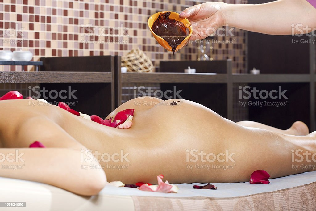 cacao therapy applied to young woman in a spa royalty-free stock photo