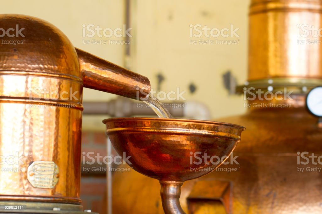 Cachaça sendo destilada stock photo