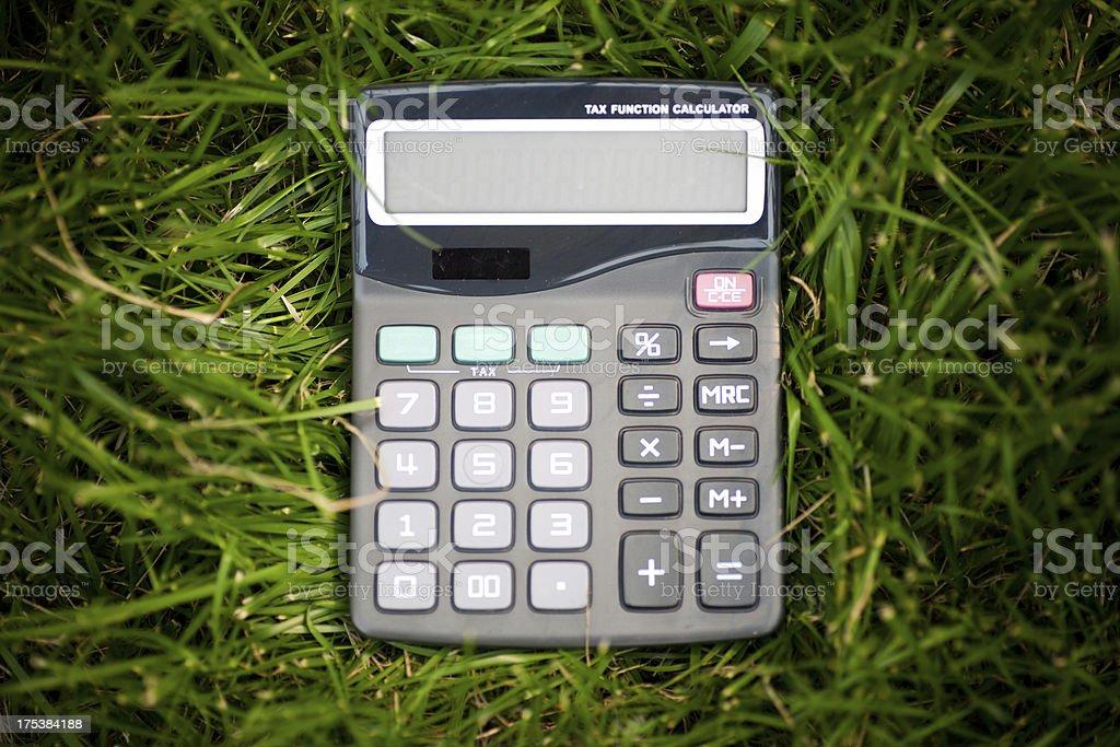 Caculator on grass stock photo