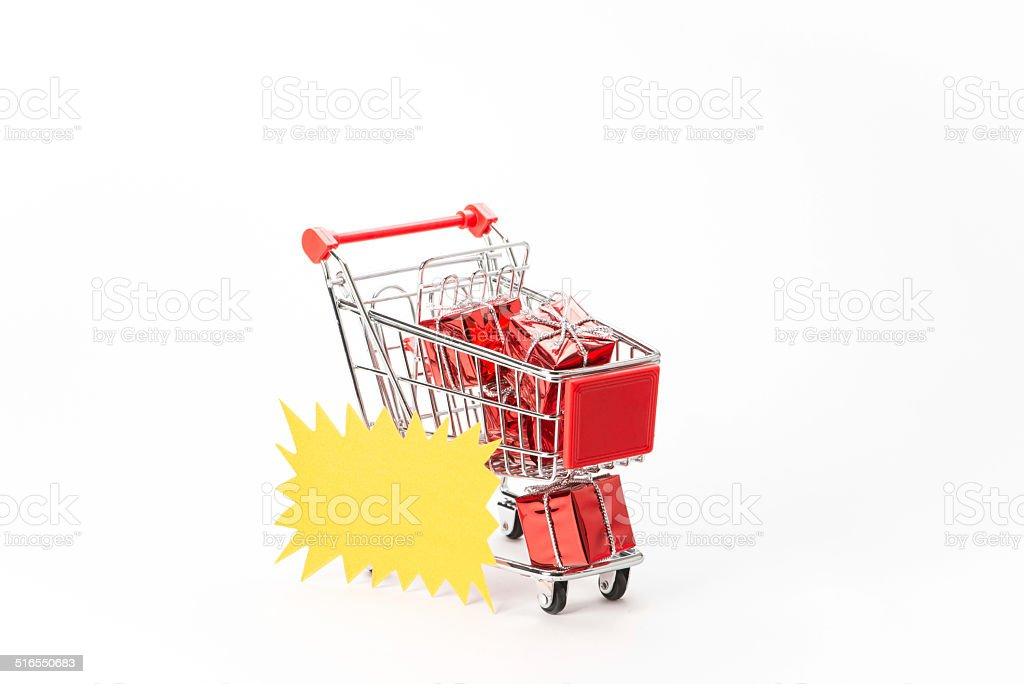 Caddy for shopping with gift stock photo