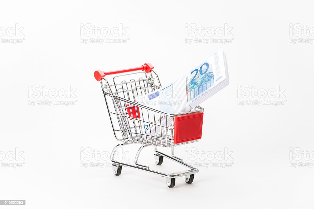 Caddy for shopping with money stack stock photo