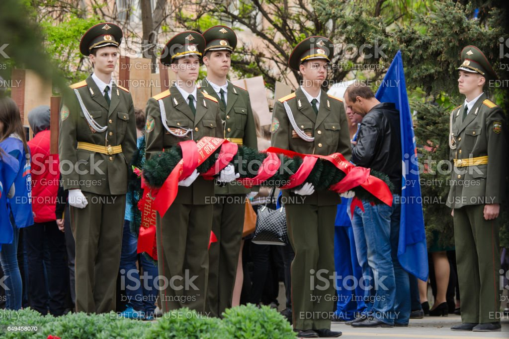 Cadets young guard with a wreath in memory of the fallen war stock photo
