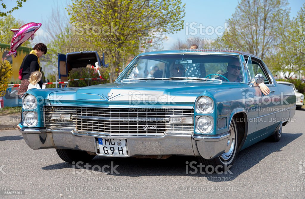 Cadillac Coupe de Ville  drives on street stock photo