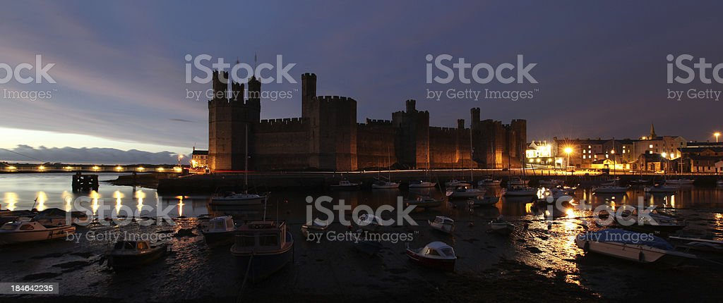 caernarfon castle at dusk panorama stock photo