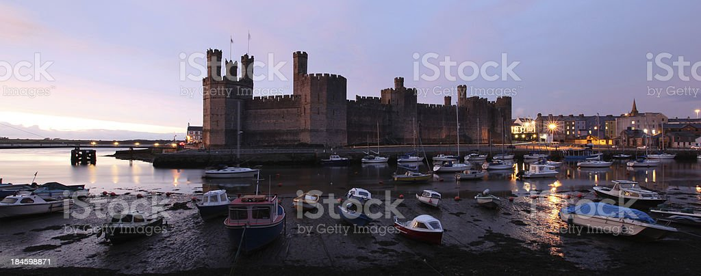 Caernarfon castle sunset panorama stock photo