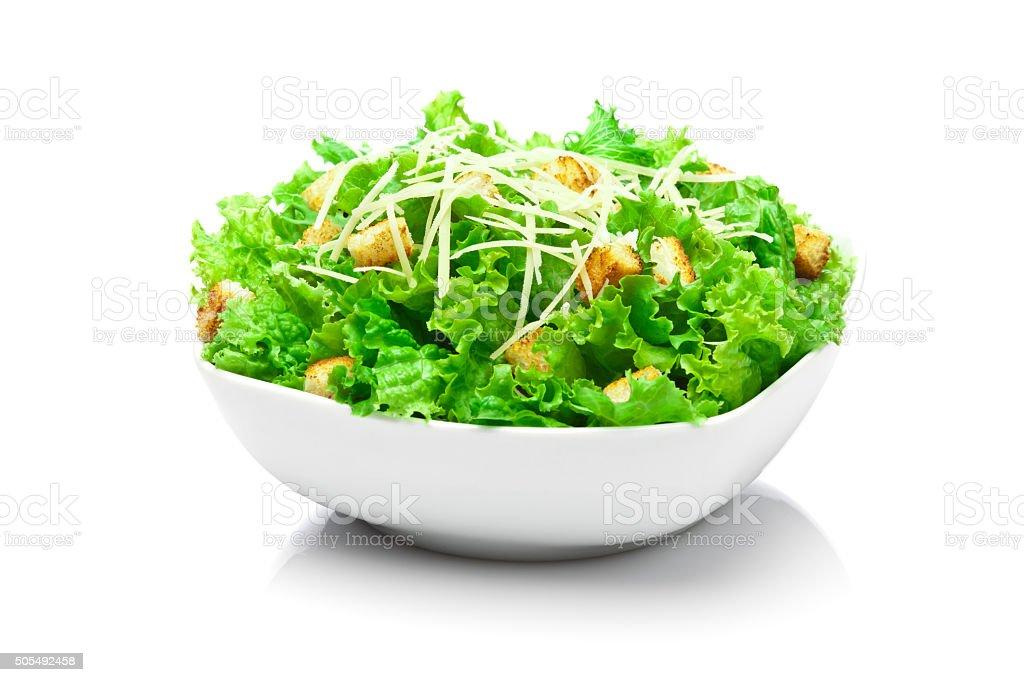 Caesar salad bowl isolated on white background stock photo