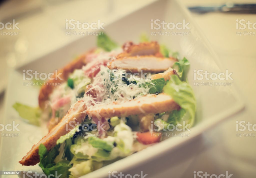 Caesar salad on a plate stock photo