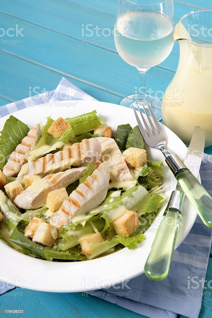 Caesar salad on the picnic table royalty-free stock photo