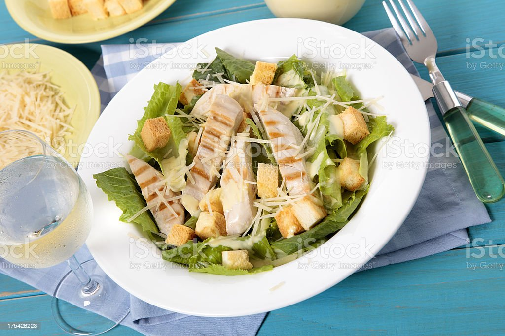 Caesar salad on the picnic table stock photo