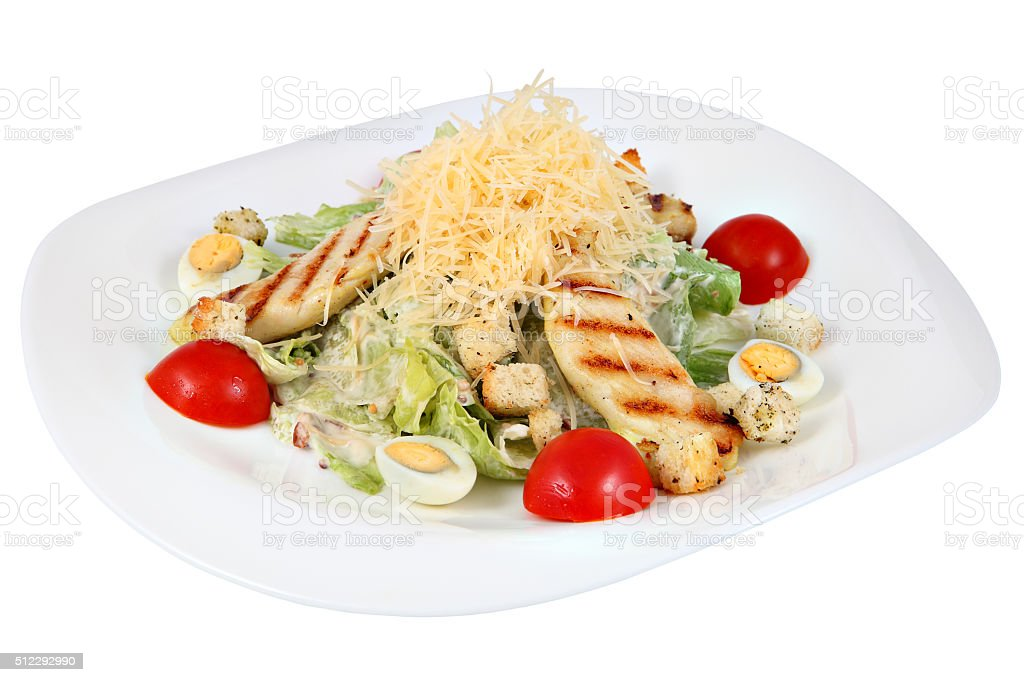 Caesar salad with fried chicken, lettuce leaves, and boiled egg. stock photo