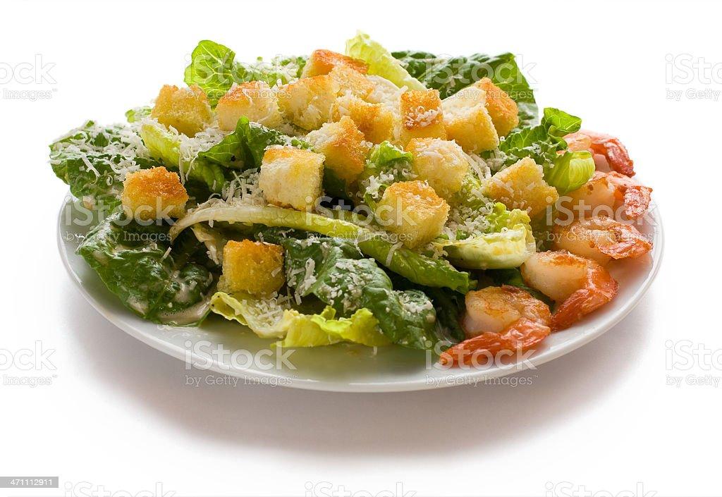 Caesar salad with fried shrimps stock photo