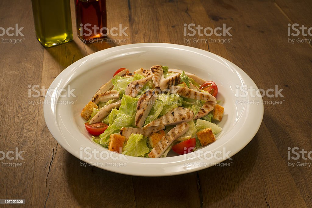 Caesar Salad with grilled chicken royalty-free stock photo