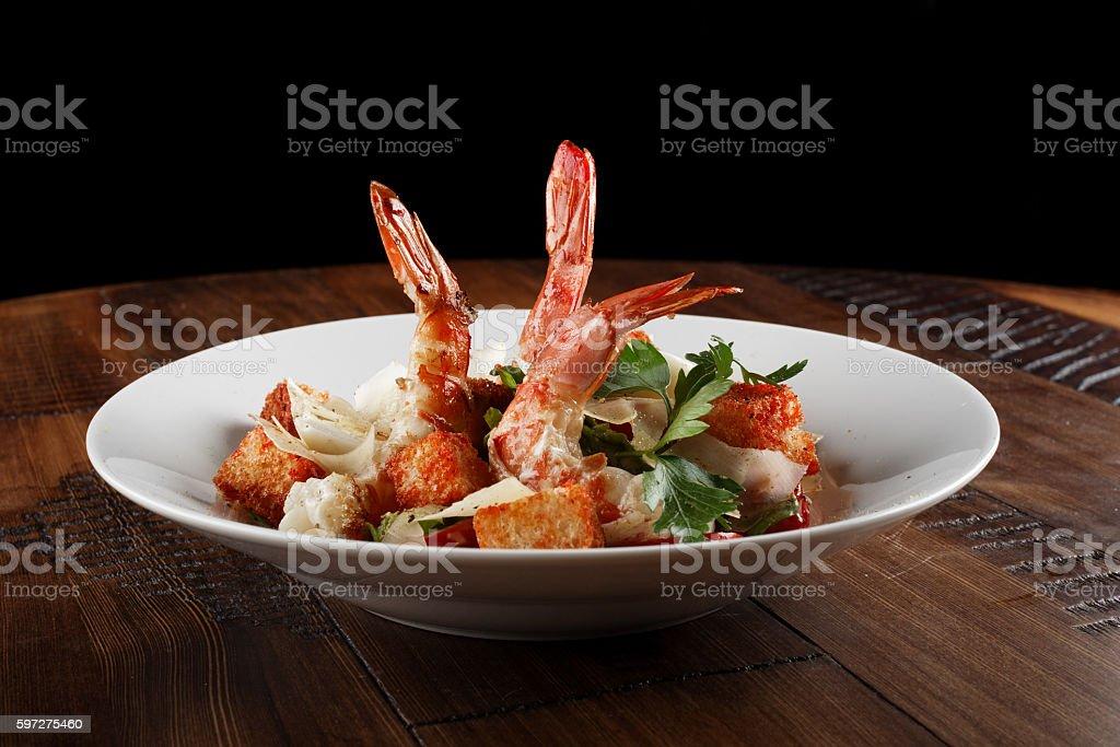 Caesar salad with king prawns stock photo