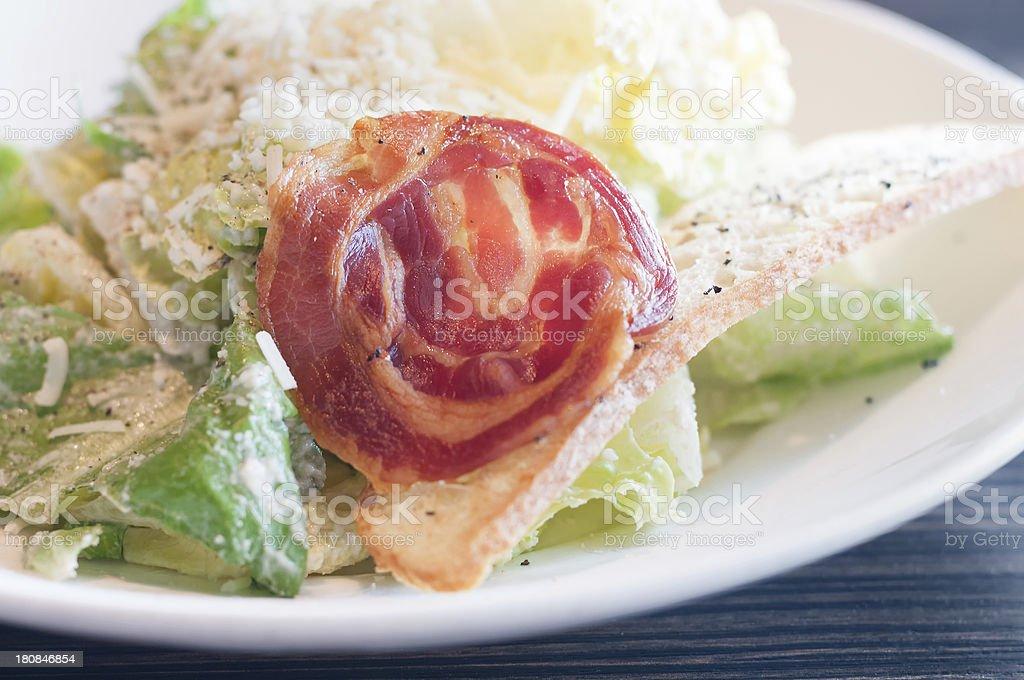 Caesar Salad with Pancetta and Crostini stock photo