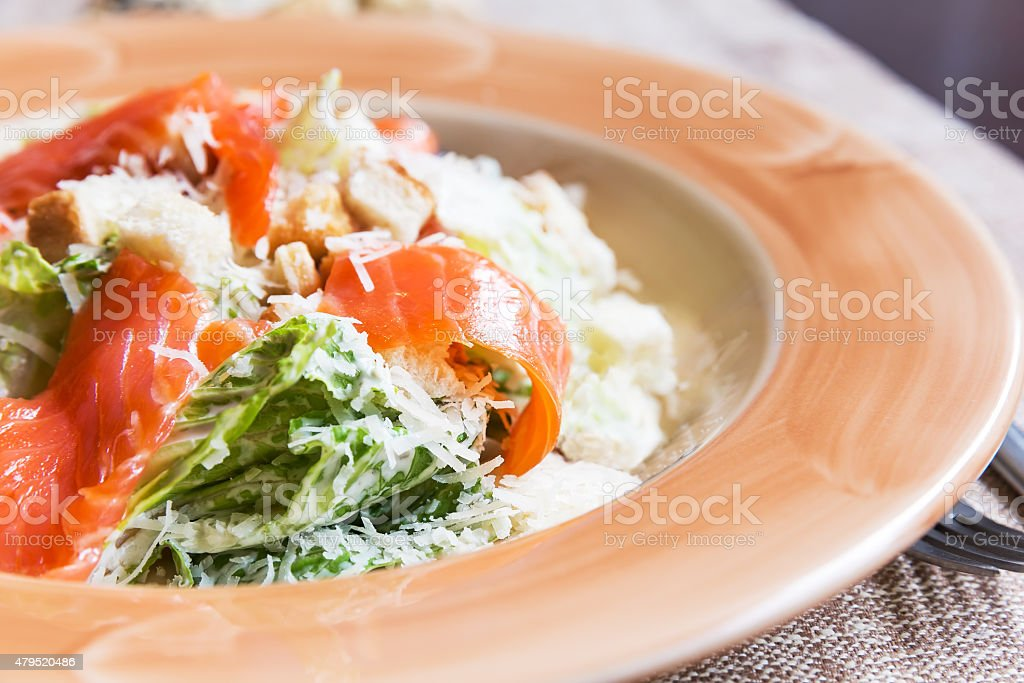 Caesar salad with salmon stock photo