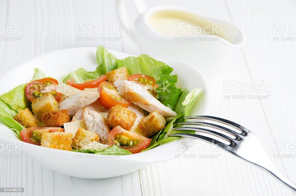 Caesar salad with sauce closeup stock photo