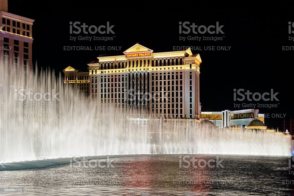 Caesars Palace Hotel is shown behind some of the fountains stock photo