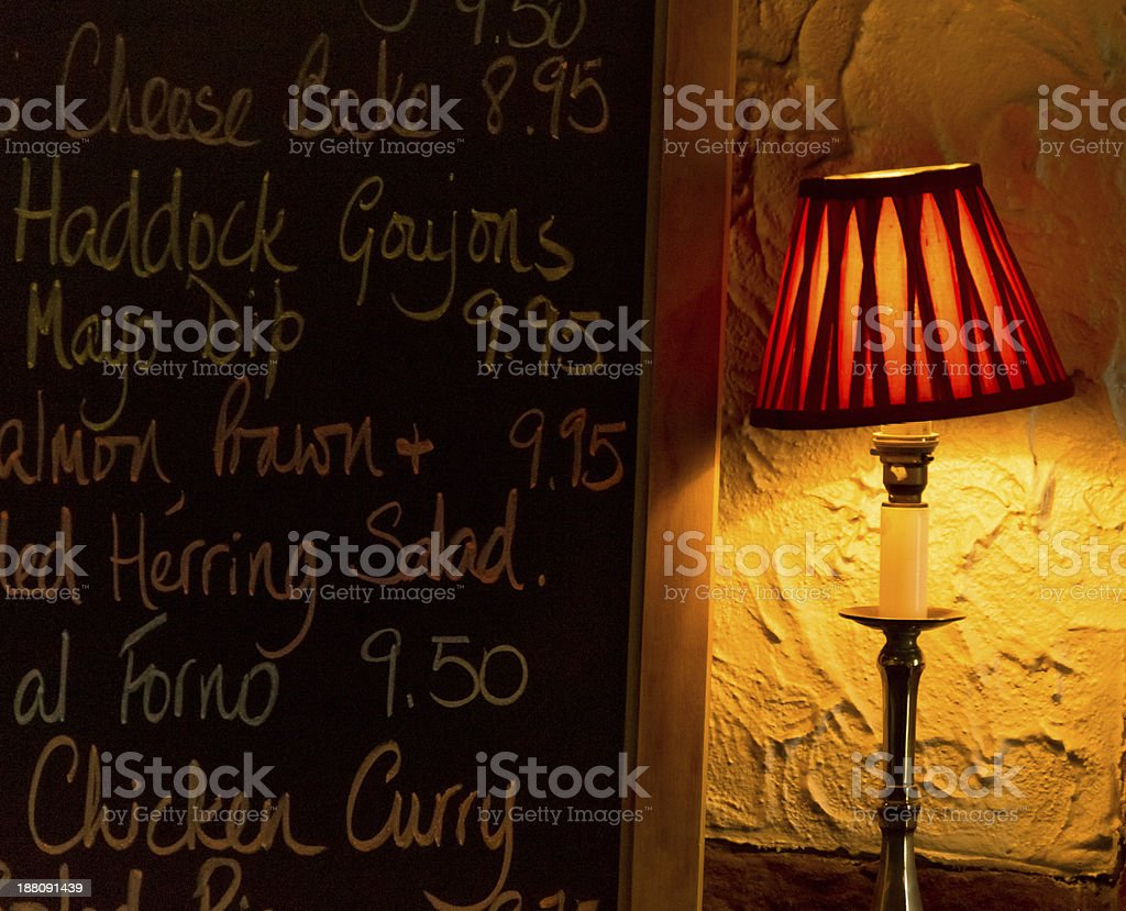 Caf? menu and a desk lamp royalty-free stock photo