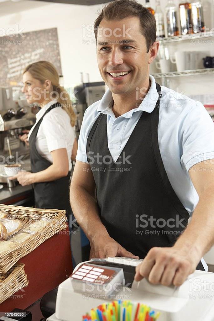 Café Staff Serving In Coffee Shop royalty-free stock photo