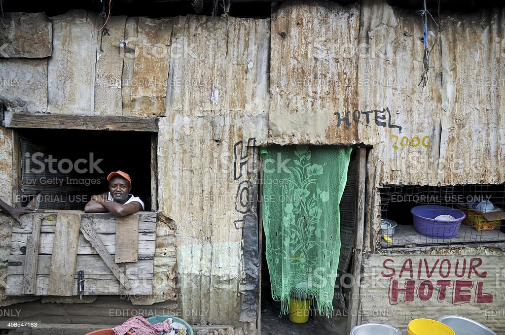 Cafe and its Owner in Nairobi Slum royalty-free stock photo