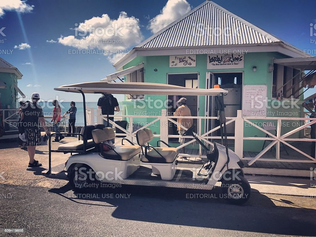 Cafe and tourists in Cockburn Town. Turks and Caicos Islands stock photo
