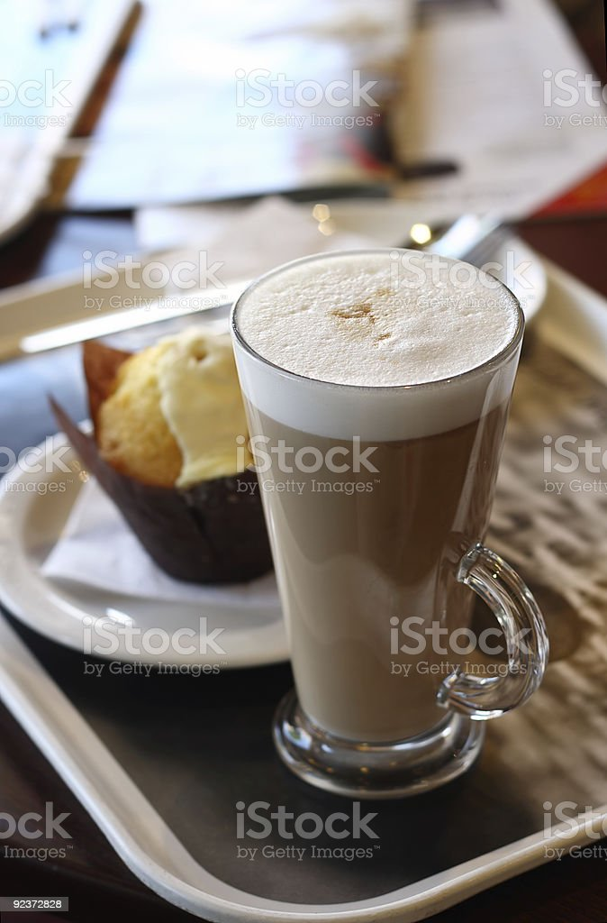 Cafe coffee - Latte in a glass with lemon muffin stock photo