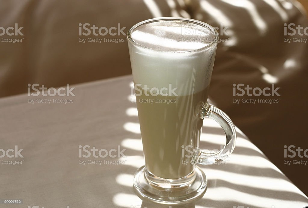 Cafe Coffee Latte in a tall glass and sunny light royalty-free stock photo