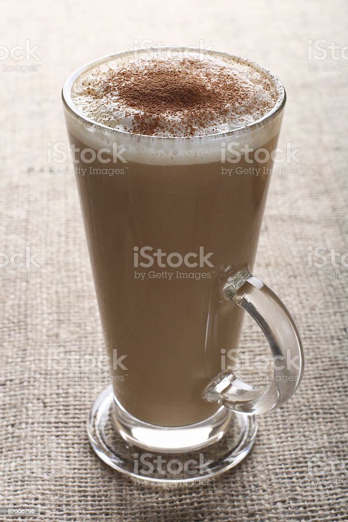 cafe - Coffee Latte with cocoa powder on burlap canvas royalty-free stock photo