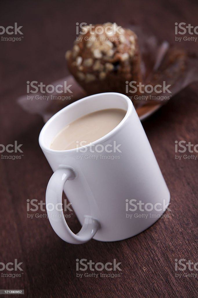 cafe con leche with an oats and raisin muffin stock photo