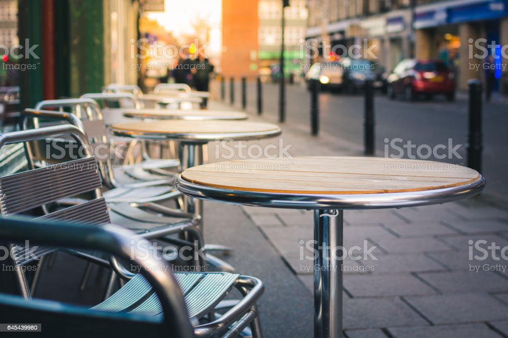 Cafe furniture on pavement stock photo
