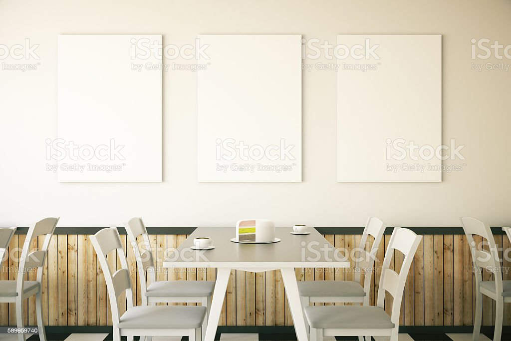 Cafe interior with three posters stock photo