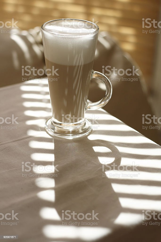 Cafe Latte in a tall glass and long shadow royalty-free stock photo