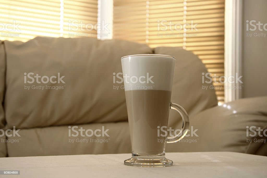 Cafe Latte in a tall glass and sofa on background royalty-free stock photo