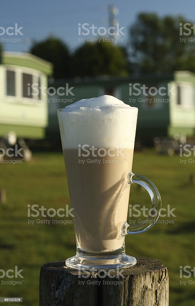 Cafe Latte in a tall glass on wood royalty-free stock photo