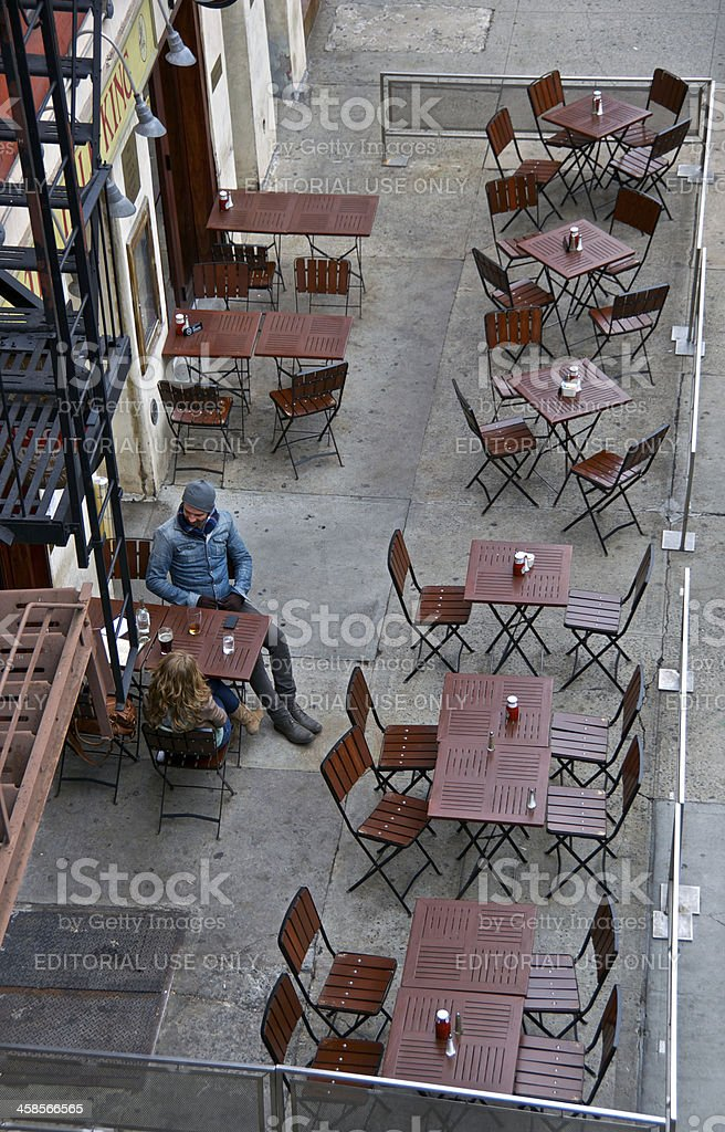 Cafe Life, New York City, Couple alone outdoors in Chelsea stock photo