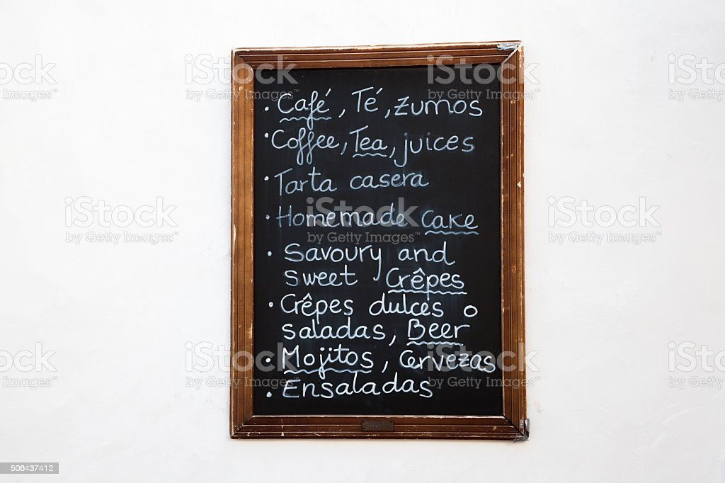 cafe menu board on white wall stock photo