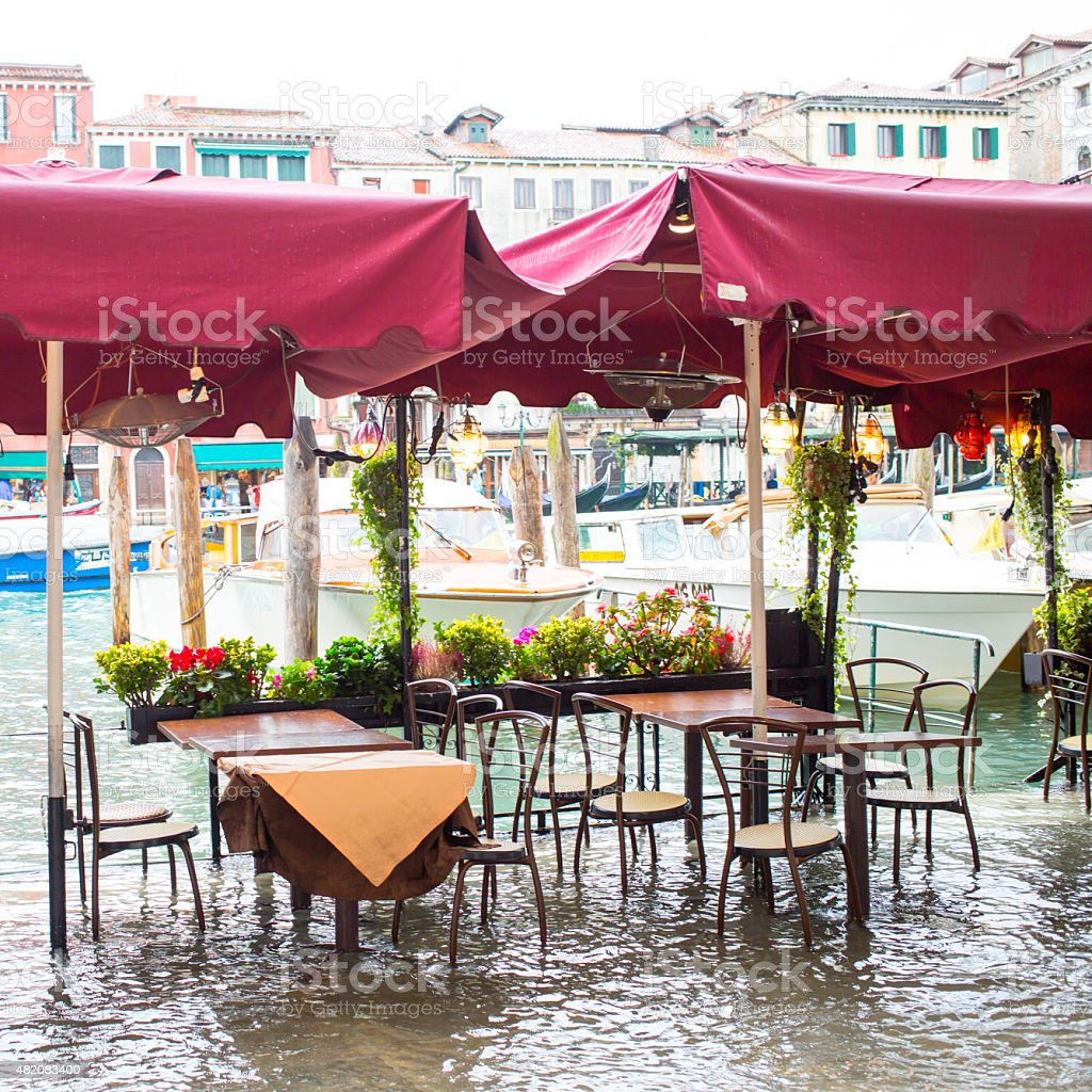 cafe restaurant tables and chairs in Venice at flood stock photo