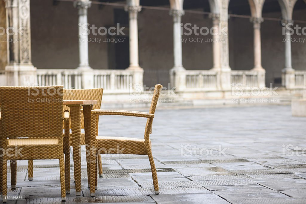 Cafe Table and Chairs in Italian Piazza royalty-free stock photo