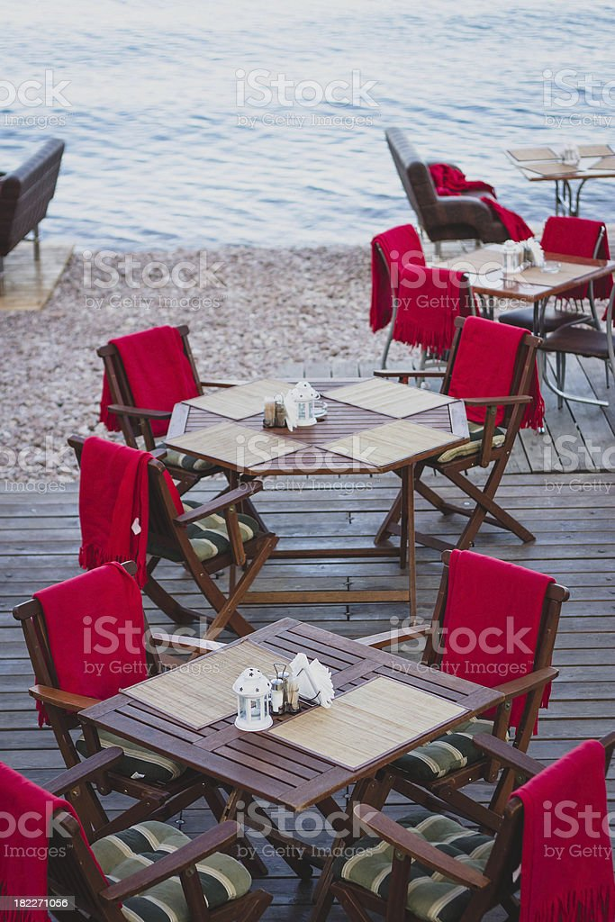 Cafe tables at the pebble beach royalty-free stock photo