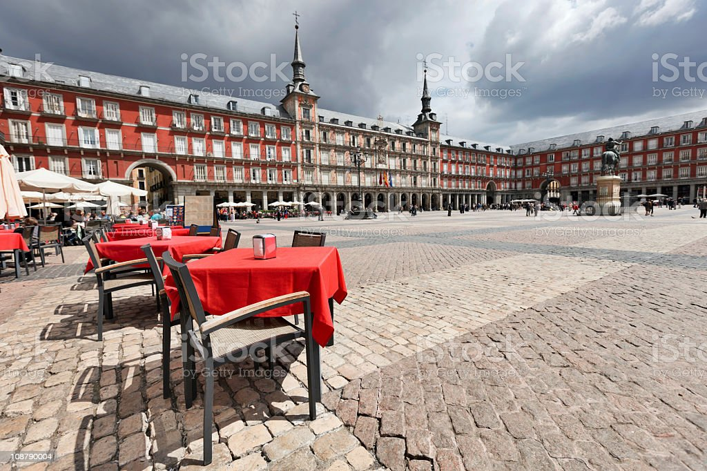 Cafe tables with red tableclothes in Plaza Mayor. Madrid. stock photo