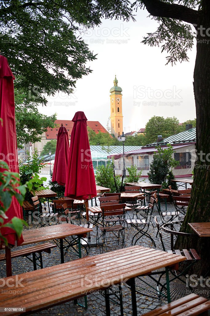 Cafe View Of The Heiliggeistkirche Clock Tower Of Munich stock photo