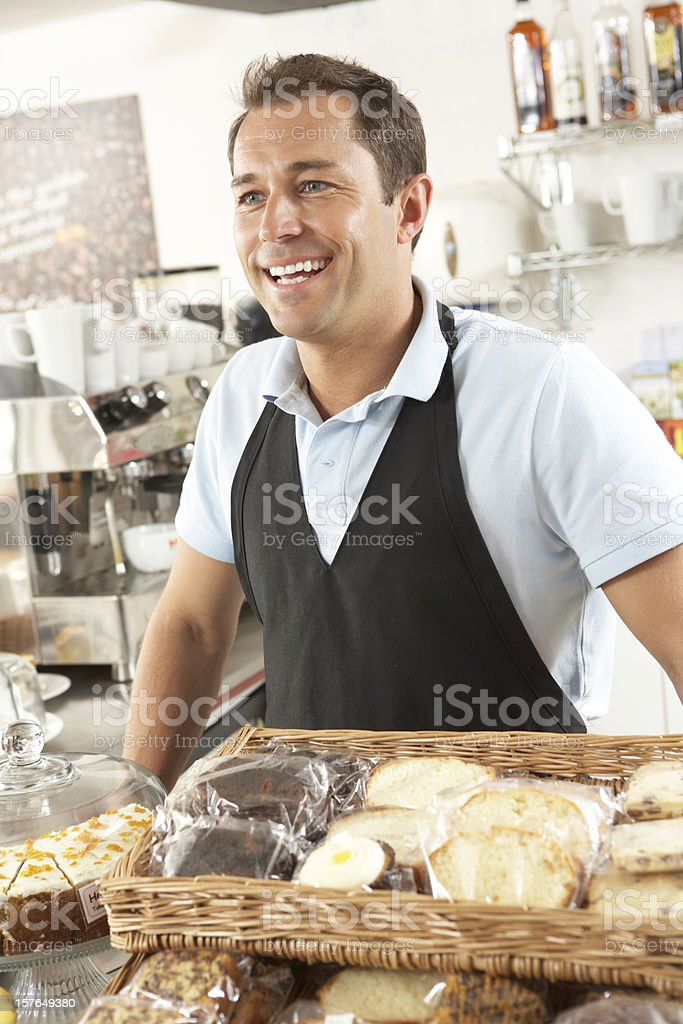 Cafe Waiter Serving In Coffee Shop royalty-free stock photo