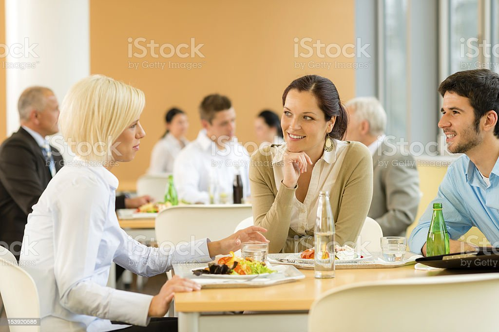 Cafeteria lunch young business people eat salad stock photo