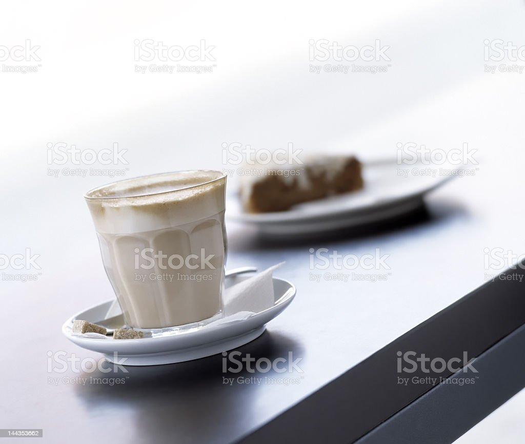 Caffe latte on a table royalty-free stock photo